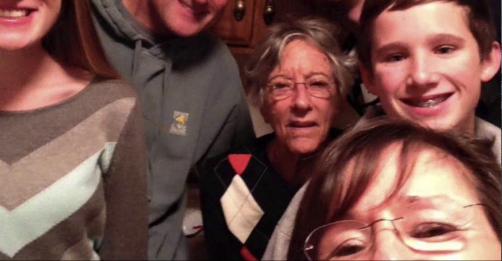 Charter Senior Living of Towson Video Thumbnail Family Group Surrounded by senior living resident