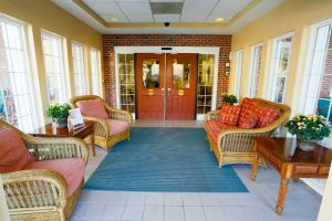 Charter Senior Living of Towson Image Gallery - Front Foyer with chairs and tables