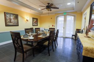 Charter Senior Living of Towson - Private Dining Room with cloth napkins and water goblets on dining table